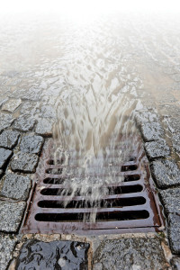 Water during a heavy rain runoff flows into