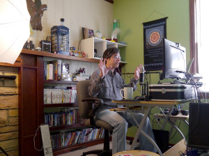 Victor Agreda Jr. at the helm of his living room broadcast studio.