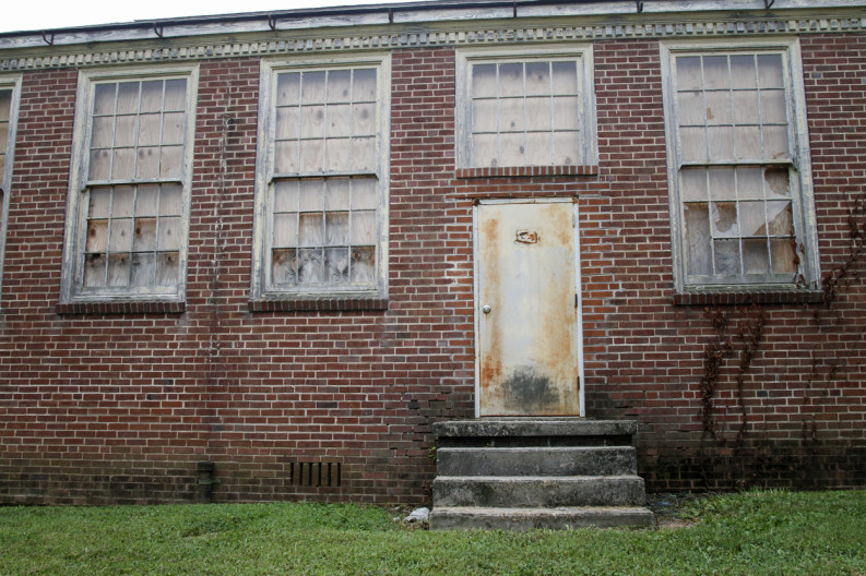 Broken windows adorn the Old South High School in Knoxville. Photo by Clay Duda.