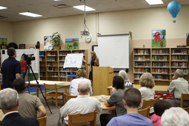 Knoxville Community Development Director Becky Wade answers questions from the crowd during a brainstorming meeting on ideas for redeveloping the Old South High School building on E. Moody Ave. Photo by Clay Duda.