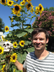 Aaron Shugart-Brown plants sunflowers in the Fourth and Gill Friendship Garden for the Labor Day Sunflower Project.