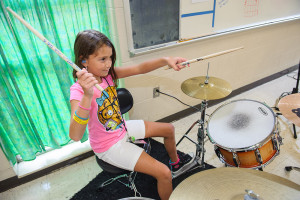 Johnica of The Daring Hues rehearses for the Knoxville Girls Rock Camp showcase.