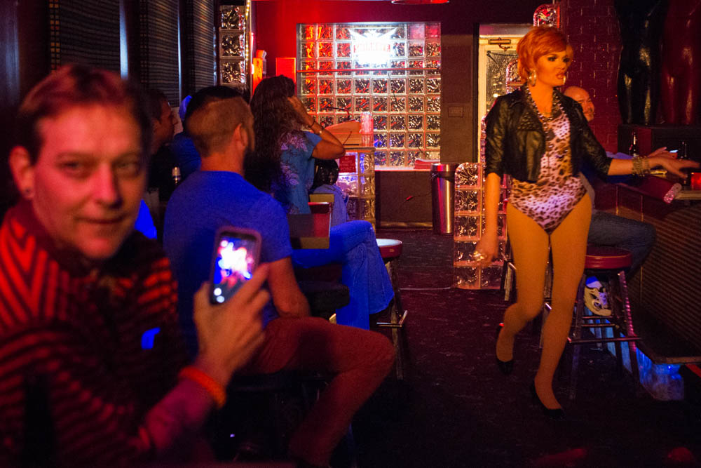 """Petunia,"" in leopard print, struts to the stage during a drag show at Club XYZ in Happy Holler on Thurs., Oct. 8, 2015. Photo by Clay Duda."