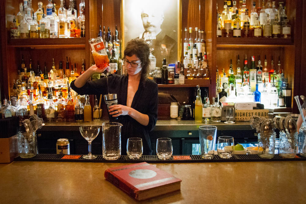 Bartender Hannah Howard mixes a series of cocktails, from left, a Dirty Martini, Rhett Butler, Sazerac, and Whiskey Smash for customers the Peter Kern Library in downtown Knoxville on Thurs,. Oct. 8, 2015. Photo by Clay Duda.