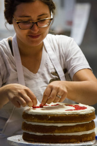 Cake Girl Samantha Spence pieces together a lemon raspberry cake at Magpies Bakery in North Knoxville on Weds., Oct. 7, 2015. Photo by Clay Duda.