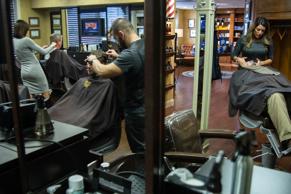 Patrons enjoy a cut and a shave at Frank's Barbershop in Bearden, a high-end traditional men's hair cuttery. Photo by Clay Duda.
