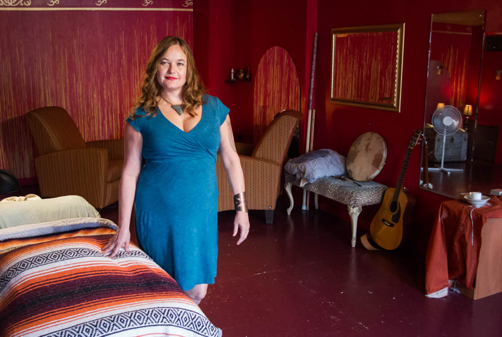 Holistic healer and licensed massage therapist Sara Griscom stands in her studio at Gypsy Hands Healing Arts Center in Historic Old North Knoxville, a practice she opened after returning to the United States from a stint in India in 2001. Photo by Clay Duda.