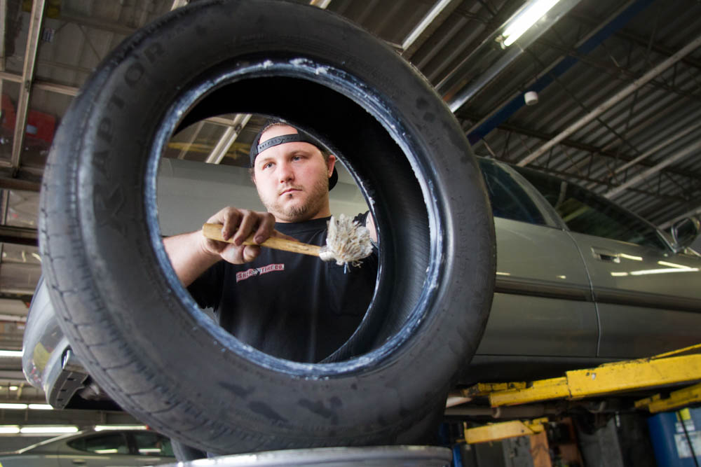 Mechanic Cody Dyer completes a tire repair at a Fisher Tire Company location in North Knoxville on Weds., Sept. 30, 2015. Photo by Clay Duda.