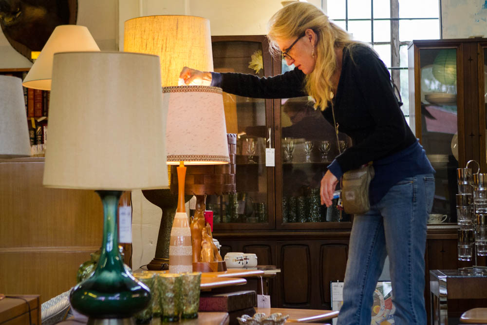 Knoxvillian Stacy Nickell browses the vintage modern furniture on display at Mid Mod Collective off N. Central Ave. on Fri., Oct. 2, 2015. Photo by Clay Duda.