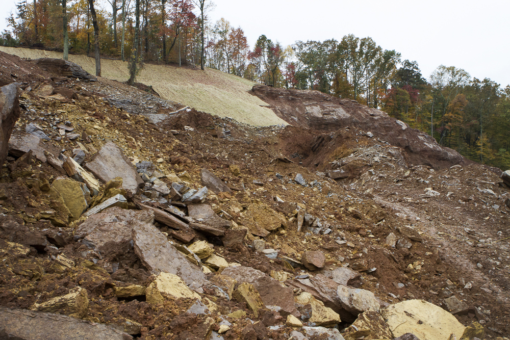 Loose rock and dirt cover the side of Chapman Ridge in South Knoxville as construstion workers back-fill tiers in November 2015 for a future student housing development. Photo by Clay Duda.