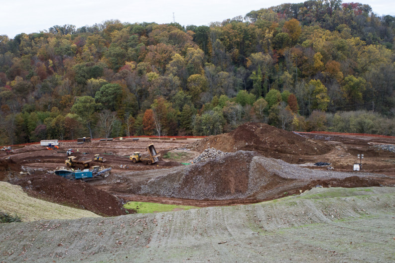 Construction workers build tiers into the side of Chapman Ridge in South Knoxville, constructing foundations for the 86-townhouse student housing complex Knox Ridge in November 2015. Photo by Clay Duda.