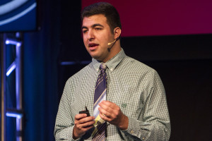 Budding entrepreneur Fadi Saleh, 22, pitches his business plan for SpareTime Entertainment, a startup specializing in viral mashup videos, during a competition at Startup Day 2015 onstage at the Bijou Theatre.