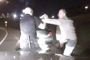 Officer David Gerlach struggles with Ronald Carden as he attempts to arrest him in July 2014. Shortly after this screen shot from Gerlach's dashboard camera video, Carden ran out of the frame and, after a continued struggle with Gerlach, was shot and killed. Carden's son has filed a lawsuit against the city and Gerlach, claiming his father was shot in the back in a display of unnecessary force and wasn't provided rapid enough medical treatment afterward.