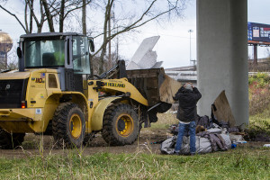 Knoxville city crews clear a homeless camp of W. Fifth Ave. on Dec. 18, 2015. In January officials plan to raze two more encampments nearby. Photo by Clay Duda.