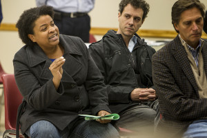 Knoxville resident Amelia Parker, 36, talks during a public meeting about design plans for a Magnolia Avenue streetscape renovation. Parker says she fears that culture in the area may be threatened through gentrification if the project moves forward.