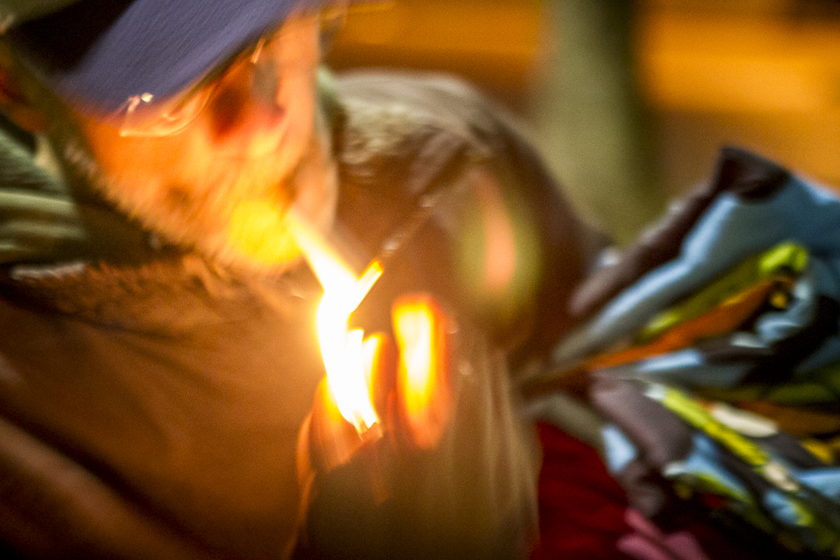 Drew Krikau lights a smoke at dawn on a cold January morning in Knoxville. Photo by Clay Duda.