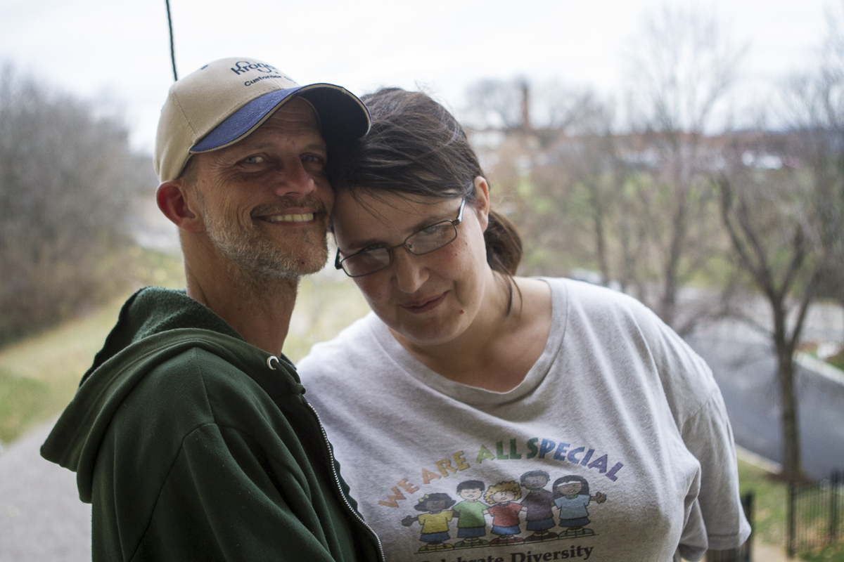 Drew Krikau and fiancee Stacy Holloway pose for a portrait. The couple has been together, homeless in Knoxville, Tennessee, for more than a year. Photo by Clay Duda.