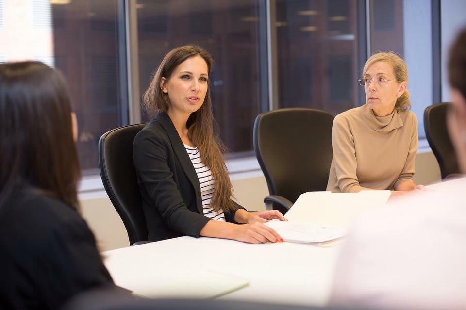 Olga Dolinina practices presenting her action plan, her mentor Sarah Cohig at her side.
