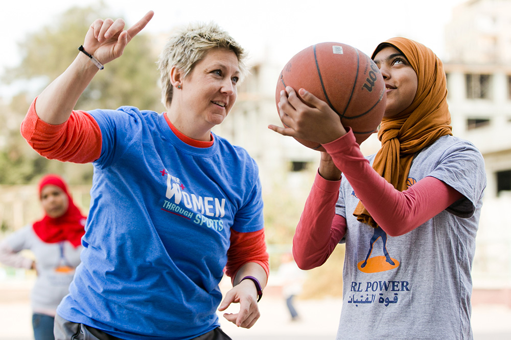 Sarah Hillyer coaches a player at a Girl Power basketball clinic in Cairo, Egypt.