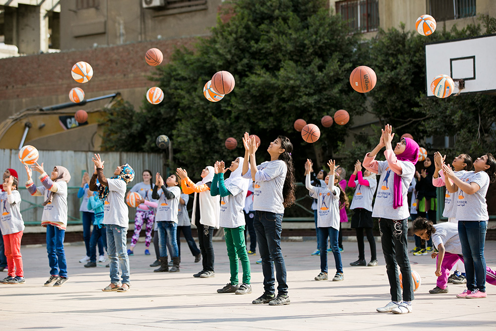 Girls practice at the Girl Power academy for basketball and life skills in Cairo, founded by a graduate of the Global Sports Mentoring Program.