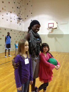 A basketball player from Senegal taught skills to girls Madyson McDonald and Emma Emory in January, 2013 at Girls Inc. in Oak Ridge.