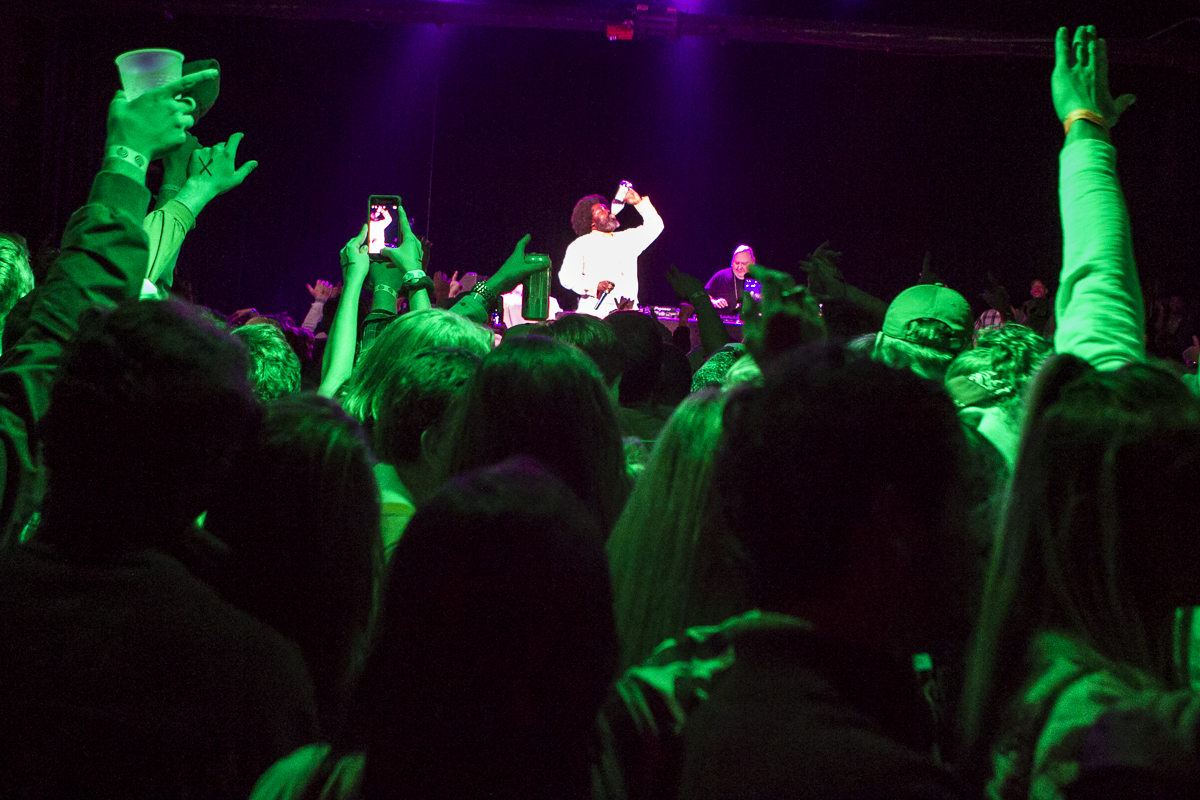 Crowds cheer as Afroman chugs 40 oz. bottle of Old English during a performance at the International, part of an afterparty thrown by four UT fraternities following the 36th Ace Miller Memorial Fraternity Boxing Tournament on Feb. 27, 2016.
