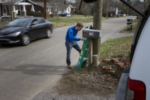 UT graduate student Drew Howe downloads data from a weather station in the Vestal neighborhood of Knoxville.