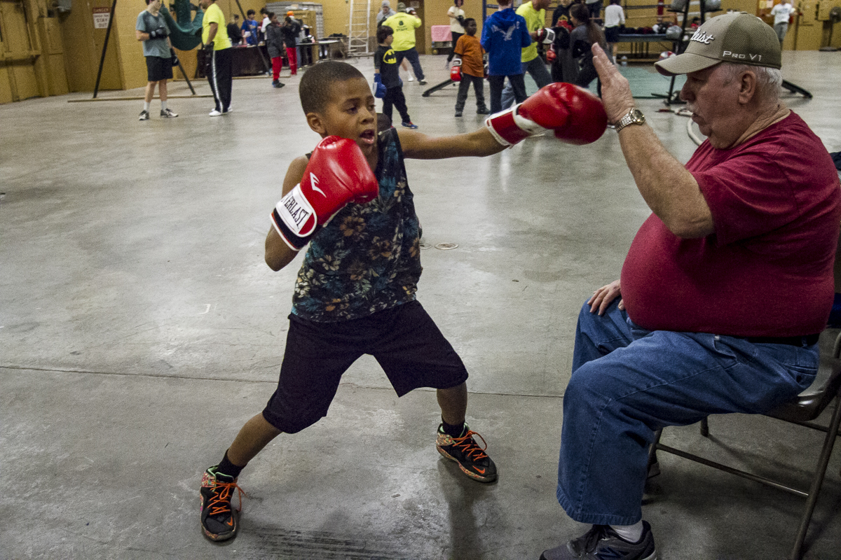 A young boxer in training hits the mark at Golden Gloves Boxing Arena on Thursday, Feb. 19, 2016. Over the previous weeks the gym has played host to dozens of fraternity brothers as they train for the 36th Ace Miller Memorial Fraternity Boxing Tournament.