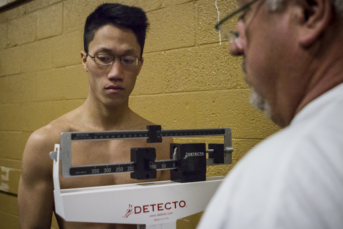 Mitchell Nguyen, of Sigma Chi, is weighed in before the 36th Ace Miller Memorial Fraternity Boxing Tournament.