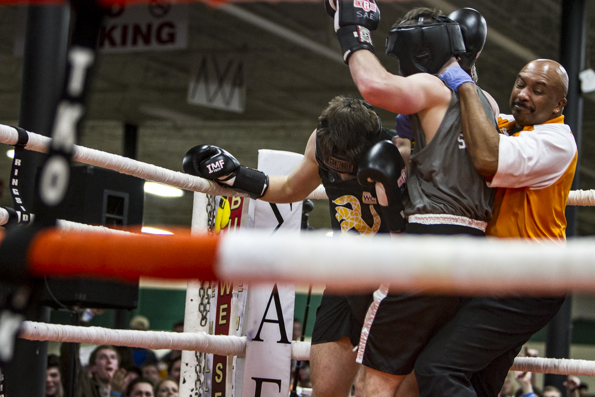 A referee pulls Mitchell Sexton off of Sigma Nu's Charles Walton during a championship fight.