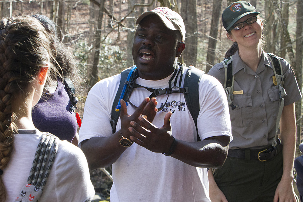 Superintendent Cassius Cash talks with a young girl during a March hike along the Little River Trail near Gatlinburg.