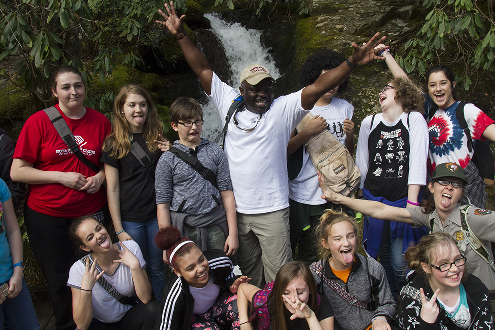GSMNP Superintendent Cassius Cash talks with a group of kids from the Boys and Girls Club on the first hike of his 'Hike 100' initiative. He plans to walk 100 miles with different youth groups to celebrate the National Park Service's centennial.