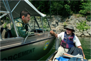 """The author being """"interrogated"""" by Kentucky Fish and Wildlife ranger Stuart Bryant on Lake Cumberland."""