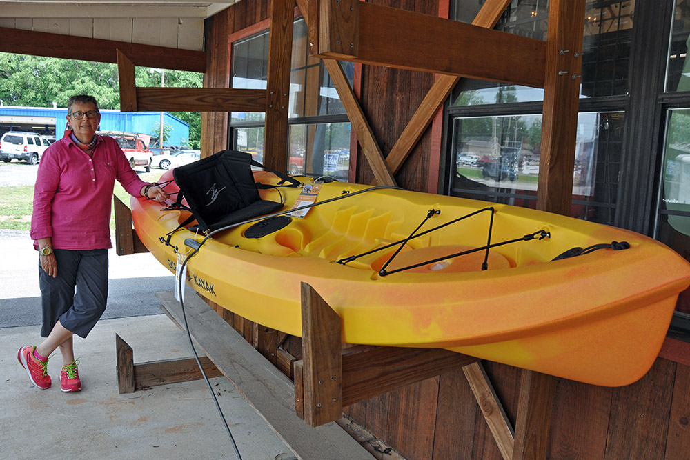 Little River Trading Company's Deborah Duda with the Ocean Kayak Scrambler 11.