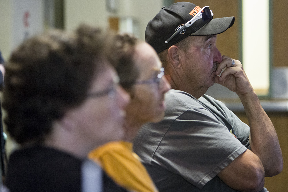 Dewight Farragut, at right in gray, listens intently to instructor Aaron Clark during a presentation on how to survive an active shooter. Farragut attended the free meeting at the Pigeon Forge Community Center with friends Leroy and Radonda Stahly, also pictured.