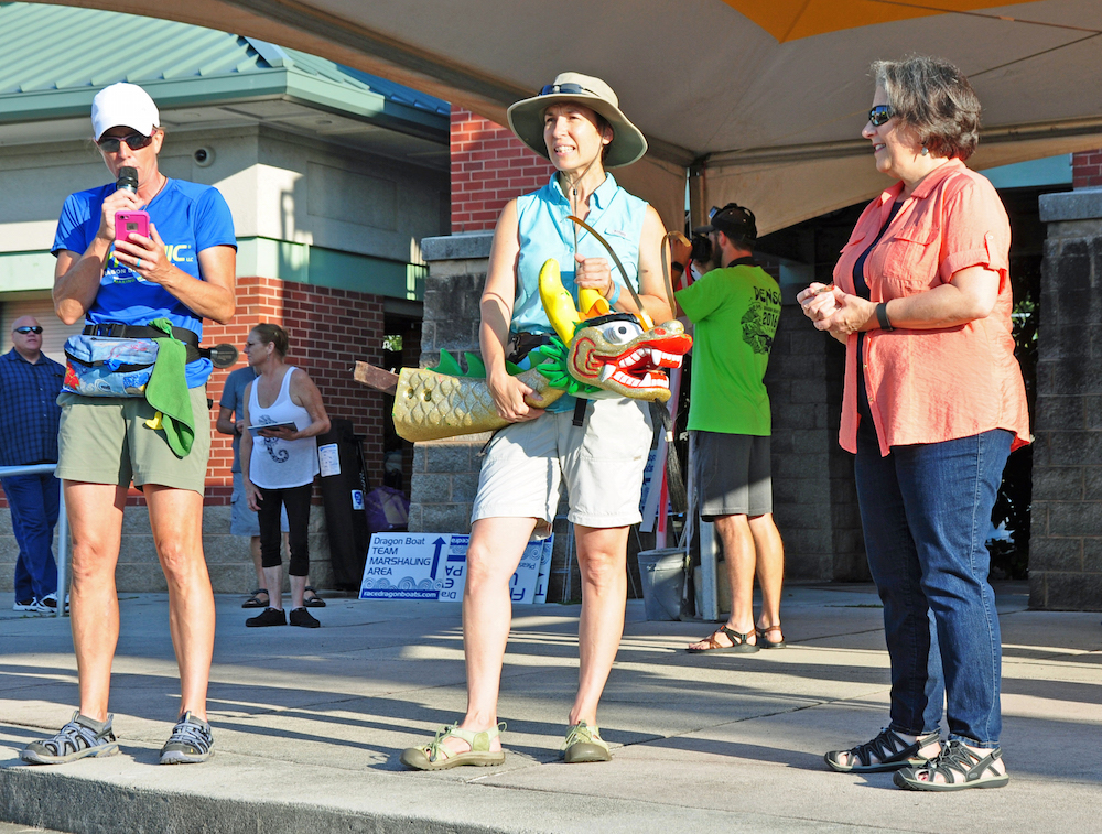 At opening ceremony, Penny Behling, owner of Dynamic Dragon Boat Racing LLC, Renee Hoyos, executive director of TCWN, and Mayor Madeline Rogero.