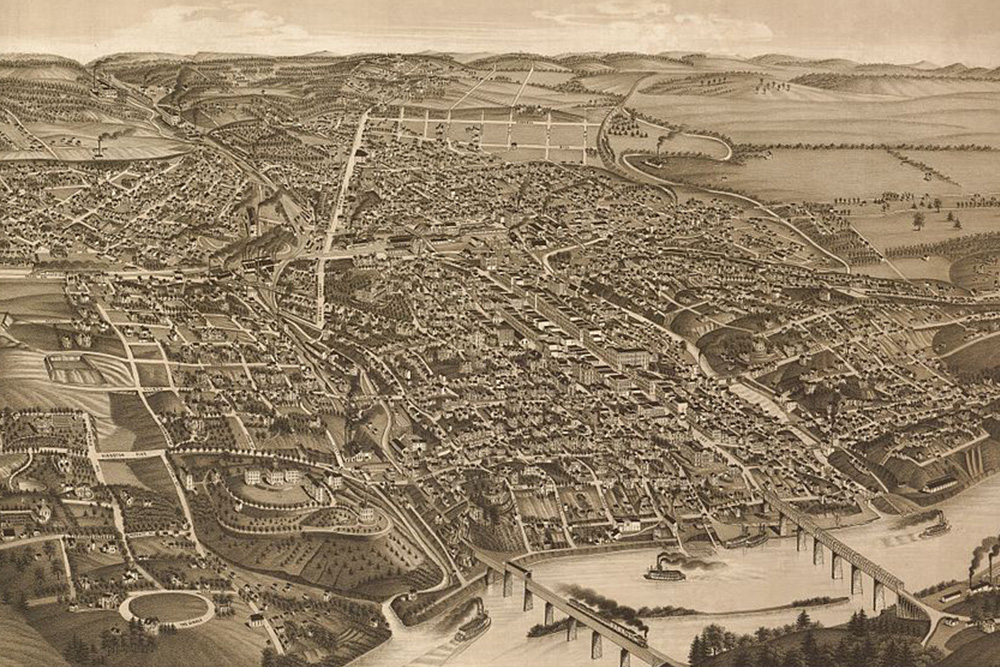 An 1886 aerial view of Knoxville (left) shows a city already well-defined to the east, along Gay Street, and bounded on the west by the Second Creek of the bluff.