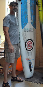 Larry Hill, a paddleboard racer at the Billy Lush Board Shop.