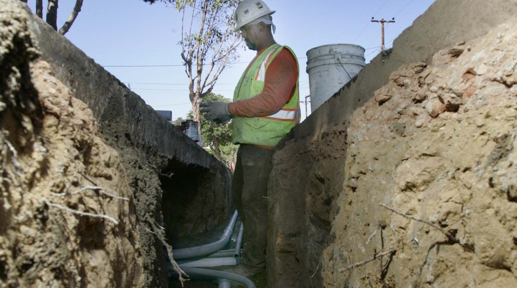 Undergrounding of electric supply lines in San Diego neighborhood.