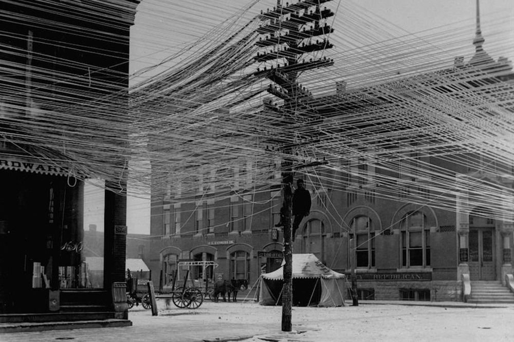 Early installation of above ground electric supply system, Pratt, Kan., 1911.