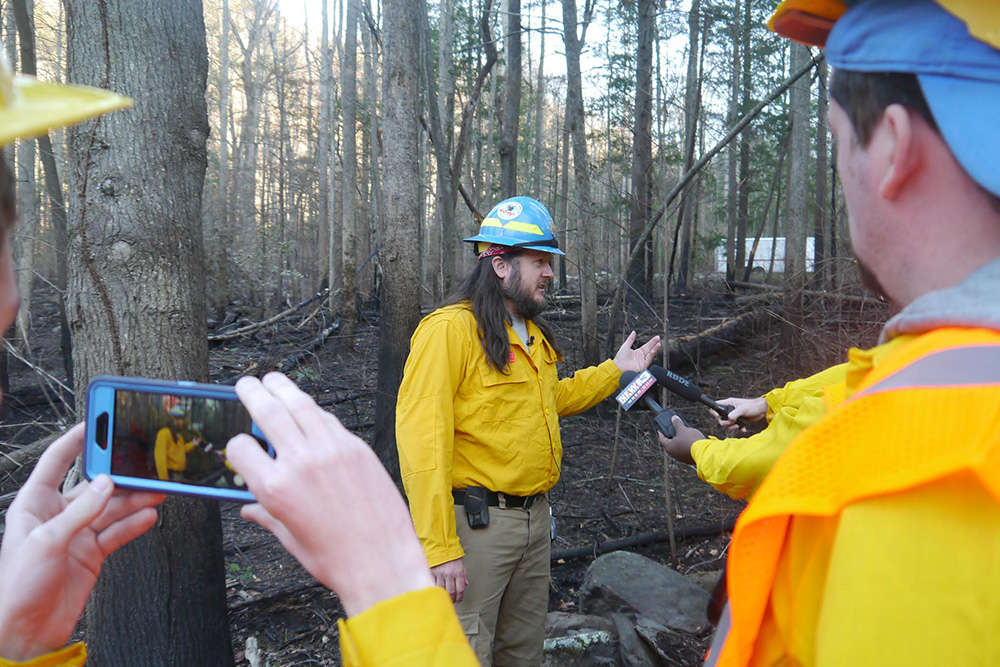 Josh O'Connor, division supervisor for the Southern Area Incident Management Team, speaks to media on Friday in the Twin Creeks section of Great Smoky Mountains National Park.